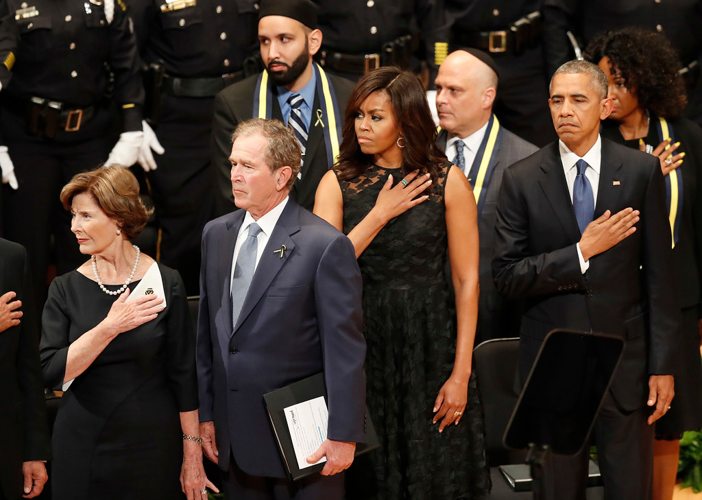 . From left, former first lady Laura Bush, former President George W. Bush, first lady Michelle Obama and President Barack Obama take part in a memorial service at the Morton H. Meyerson Symphony Center with the families of the fallen police officers, Tuesday, July 12, 2016, in Dallas. Five police officers were killed and several injured during a shooting in downtown Dallas on Thursday night. (AP Photo/Eric Gay)