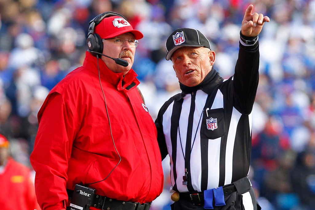 . Kansas City Chiefs head coach Andy Reid, left, talks with side judge Tom Hill during the second quarter of an NFL football game in Orchard Park, N.Y., Sunday, Nov. 3, 2013. (AP Photo/Bill Wippert)