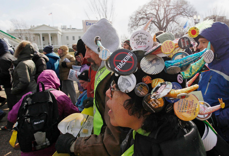 . Demonstrators march past the White House during a rally against the Keystone XL pipeline in Washington, February 17, 2013. The TransCanada Corp pipeline would link the oil sands of northern Alberta, the world\'s third largest crude resource, to refineries and ports in Texas. Environmentalists say approval of the pipeline will encourage more development in the oil sands, where extraction is carbon intensive, leading to greater greenhouse gas emissions. REUTERS/Richard Clement