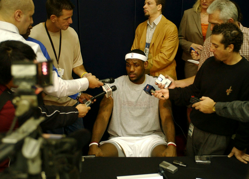 . MORNING JOURNAL/DAVID RICHARD Reporters gather around LeBron on Media Day at Quicken Loans Arena.