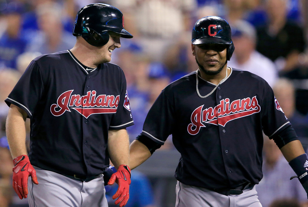 . Cleveland Indians\' Jay Bruce, left, is congratulated by Edwin Encarnacion following his three-run home run during the seventh inning of a baseball game against the Kansas City Royals at Kauffman Stadium in Kansas City, Mo., Friday, Aug. 18, 2017. (AP Photo/Orlin Wagner)