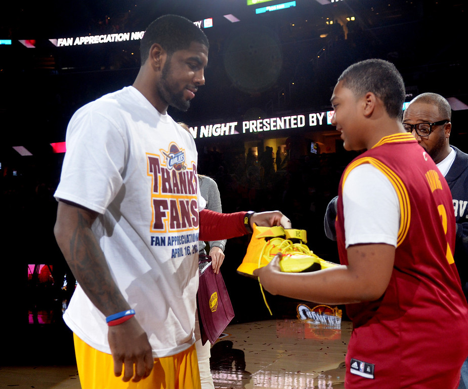 . Michael Allen Blair/Digital First Media Cavs\' guard Kyrie Irving gives his game shoes to Brandon Armstrong of Twinsburg after a game at Quicken Loans Arena on April 16.