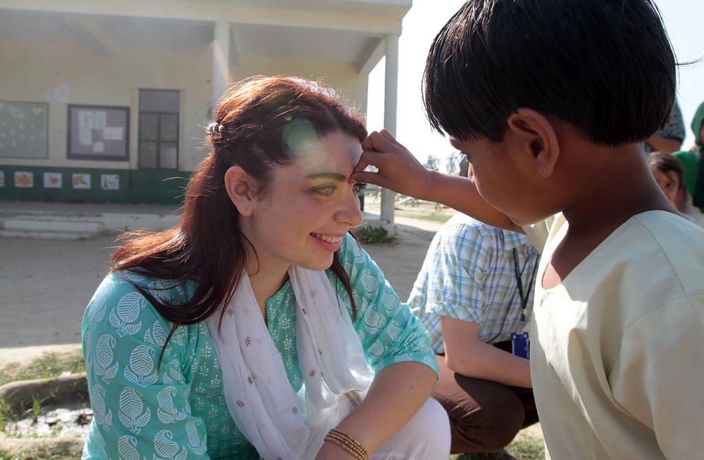 . Mount Madonna School\'s Karina Fox, of Soquel, is given a pink-colored tillak  on her forehead by one of the youngest students at Pardada Pardadi School in Anupshahr, India on March 26 as the students pepare to celebrate Holi, an Indian holiday filled with color. The tilak is applied to bring good luck. 