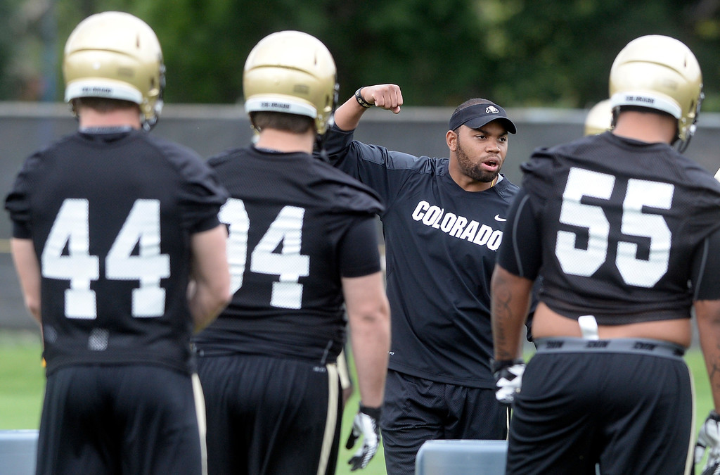 . University of Colorado assistant coach Charles Clark talks to the defense during the second fall football practice on Wednesday, Aug. 7, at the CU practice fields. For more photos of practice go to www.dailycamera.com Jeremy Papasso/Camera