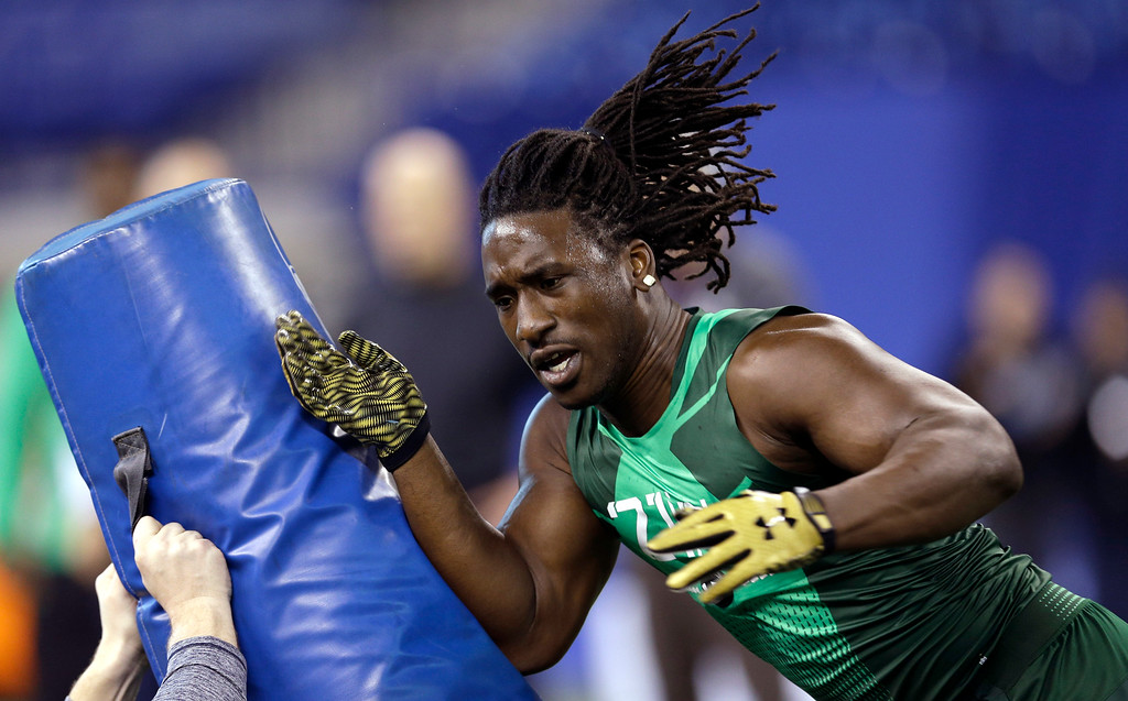 . Missouri defensive lineman Markus Golden runs a drill at the NFL football scouting combine in Indianapolis, Sunday, Feb. 22, 2015. (AP Photo/David J. Phillip)