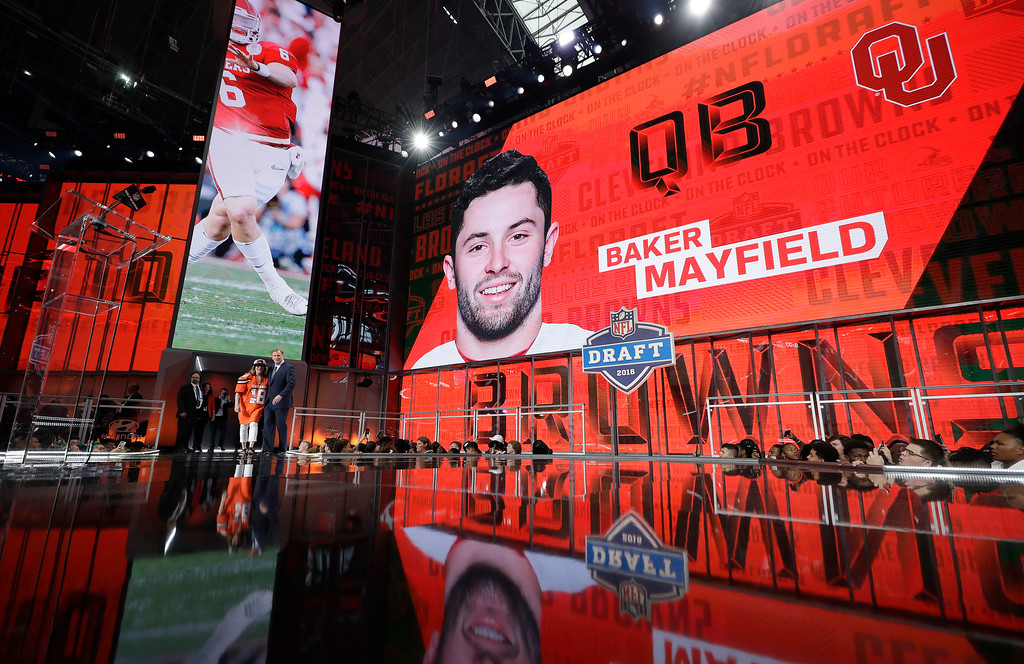 . Commissioner Roger Goodell poses on stage after the Cleveland Browns selected Oklahoma\'s Baker Mayfield during the first round of the NFL football draft, Thursday, April 26, 2018, in Arlington, Texas. (AP Photo/David J. Phillip)