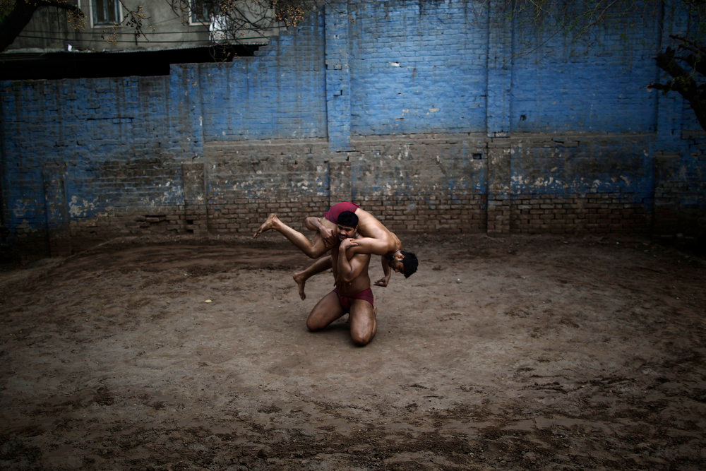 Description of . Pakistani Kushti wrestlers fight in the ring, during their daily training, at a wrestling club in Lahore, Pakistan, Tuesday, Feb. 26, 2013. Kushti, an Indo-Pakistani form of wrestling, is several thousand years old and is a national sport in Pakistan. (AP Photo/Muhammed Muheisen)