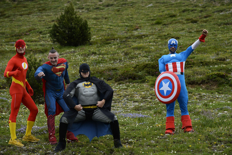 . Supporters disguised as super heros pose along the road during the 177 km fourteenth stage of the 101st edition of the Tour de France cycling race on July 19, 2014 between Grenoble and Risoul, eastern France.  (LIONEL BONAVENTURE/AFP/Getty Images)