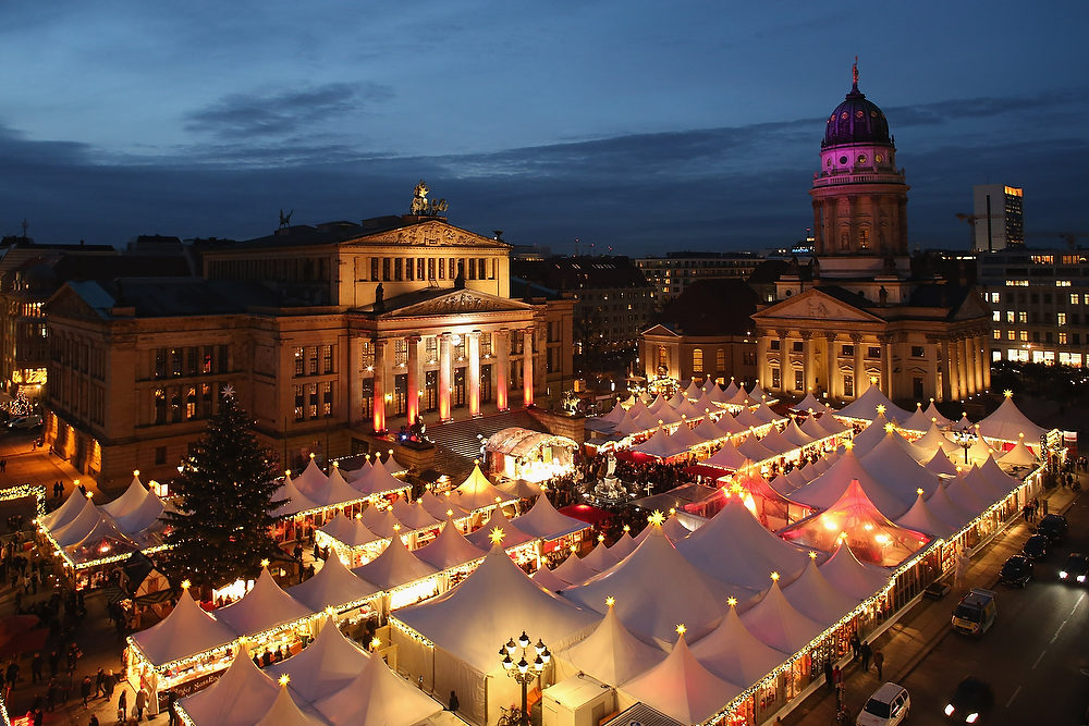 Description of . The annual Christmas market at Gendarmenmarkt stands illuminated in the city center on its opening day on November 26, 2012 in Berlin, Germany. Christmas markets, with their stalls selling mulled wine, Christmas tree decorations and other delights, are an integral part of German Christmas tradition, and many of them opened across Germany today.  (Photo by Sean Gallup/Getty Images)
