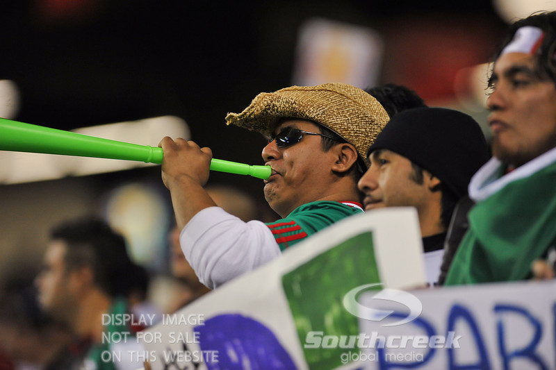 A fan makes noise with a vuvuzela during Soccer action between Bosnia-Herzegovina and Mexico.  Mexico defeated Bosnia-Herzegovina 2-0 in the game at the Georgia Dome in Atlanta, GA.