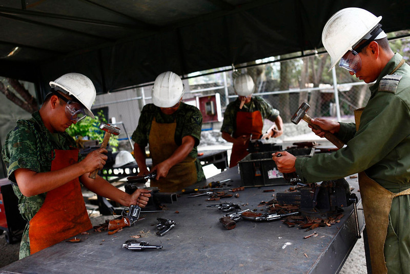 . Soldiers destroy confiscated weapons by national security authorities at a military zone of Mexico City April 17, 2013. The military is in charge of storing and destroying weapons, not only those handed in by the civilian population sometimes including those inherited from an ancestor who might have fought in the revolution but also the weapons confiscated in the six-year-long, ongoing drug war that has so far killed some 70,000 people. Picture taken April 17, 2013. REUTERS/Edgard Garrido