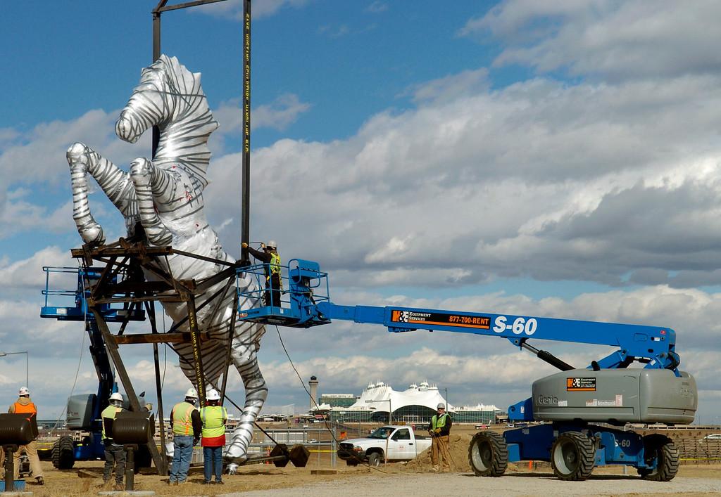 ". The Luis Jimenez \""Mustang\"" sculpture arrives and is erected at Denver International Airport on Monday, Feb. 11, 2008. Kathryn Scott Osler, The Denver Post"