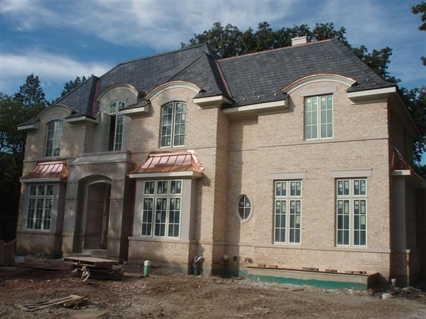 Natural Slate & Custom Copper Roof – Glencoe, IL This projects was installing a natural slate roof along with custom copper highlights for our client located in Glencoe, IL. A+ BBB Rating!