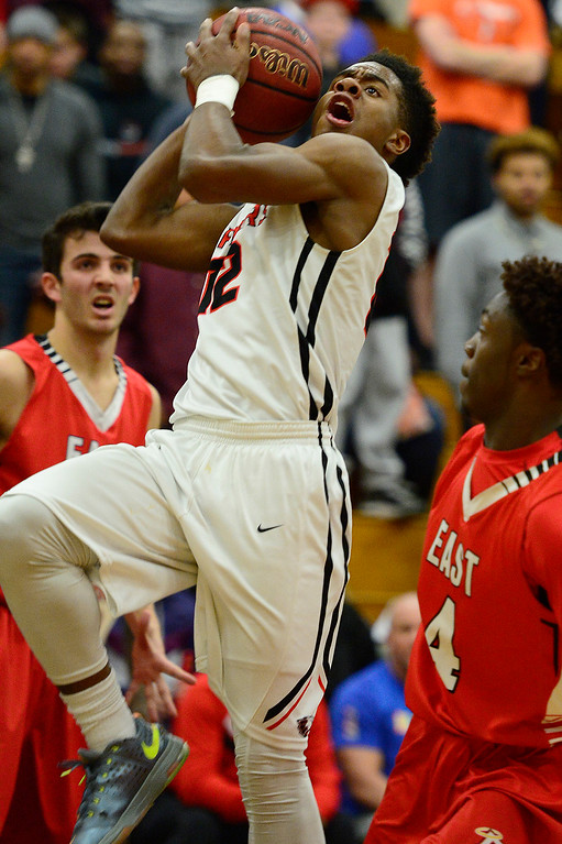 . CENTENNIAL, CO - MARCH 2: Victor Garnes of Eaglecrest (12) goes up for a layup through a slew of Denver East defenders during the second quarter at Eaglecrest High School on March 2, 2016 in Centennial, Colorado. Eaglecrest defeated Denver East 56-46. (Photo by Brent Lewis/The Denver Post)
