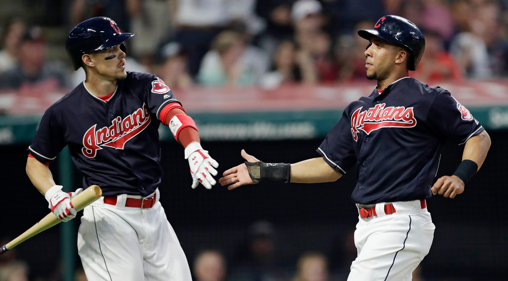 . Cleveland Indians\' Michael Brantley, right, is congratulated by Brandon Guyer after Brantley scored on Edwin Encarnacion\'s single in the seventh inning of a baseball game, Tuesday, June 19, 2018, in Cleveland. The Indians won 6-3. (AP Photo/Tony Dejak)