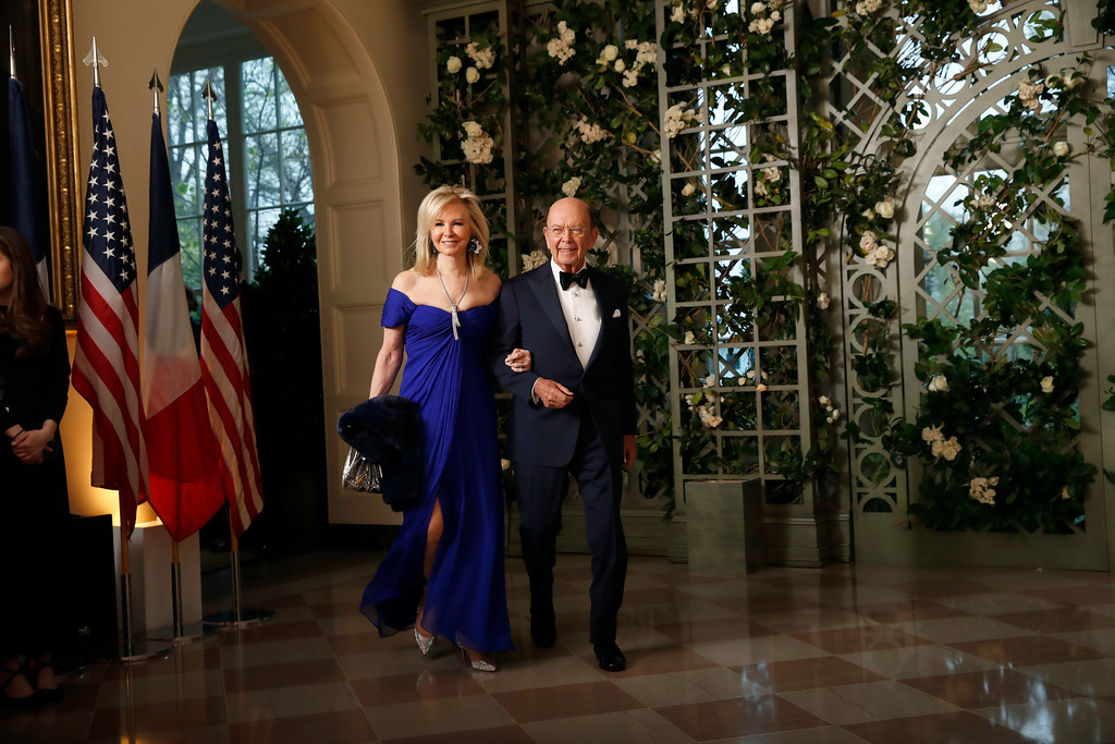 . Commerce Secretary Wilbur Ross, right, and his wife Hilary Ross arrive for a State Dinner with French President Emmanuel Macron and President Donald Trump at the White House, Tuesday, April 24, 2018, in Washington. (AP Photo/Alex Brandon)