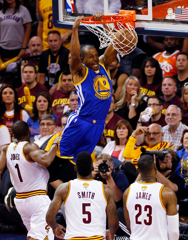 . Golden State Warriors guard Andre Iguodala (9) dunks against Cleveland Cavaliers forward James Jones (1) during the second half of Game 6 of basketball\'s NBA Finals in Cleveland, Tuesday, June 16, 2015. (AP Photo/Paul Sancya)