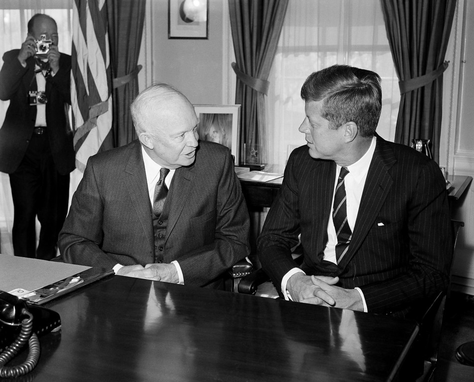 . President-elect Kennedy listens as President Dwight Eisenhower comments at the White House on Dec. 6, 1960. Eisenhower later took Kennedy  on a tour of the Executive Mansion. Associated Press file