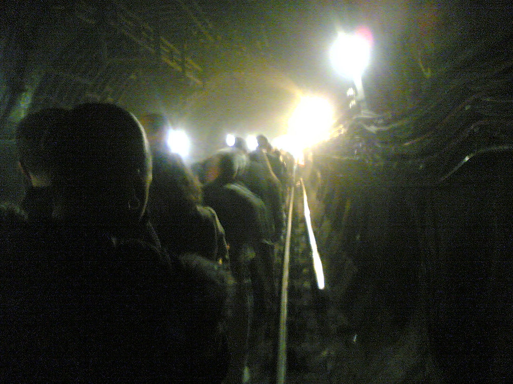Description of . Passengers are evacuated from an underground train in a tunnel near Kings Cross station in London, Thursday, July 7, 2005. At least 33 people were killed Thursday in three explosions in London's subway system, a senior police official said.  Deputy Assistant Commissioner Brian Paddick said others died in an explosion on a bus in central London but gave no figures. The second blast, at 8:56 a.m., in the King's Cross area of north London, killed 21, Paddick said. (AP Photo / Alexander Chadwick)