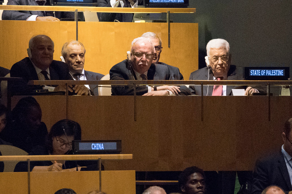 . Palestinian President Mahmoud Abbas, right listens as U.S. President Donald Trump speaks during the 72nd session of the United Nations General Assembly at U.N. headquarters, Tuesday, Sept. 19, 2017. (AP Photo/Mary Altaffer)