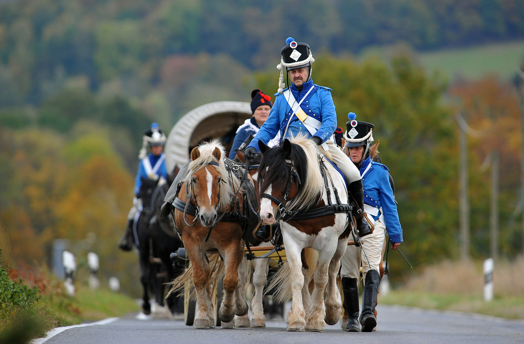 . Members of a local historical society dressed as soldiers of the 8th Artillery Regiment, 5th Division Dufour serving under Napoleon begin their four-day march to Leipzig on October 14, 2013 in Schellenberg, Germany. (Photo by Matthias Rietschel/Getty Images)