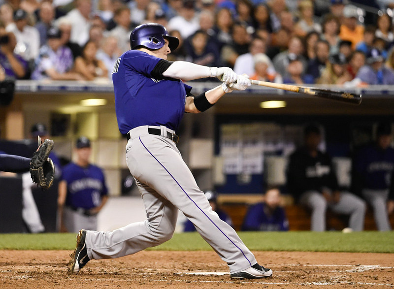 . Corey Dickerson #6 of the Colorado Rockies hits a three run home run during the sixth inning of a baseball game against the San Diego Padres at Petco Park August, 11, 2014 in San Diego, California.  (Photo by Denis Poroy/Getty Images)