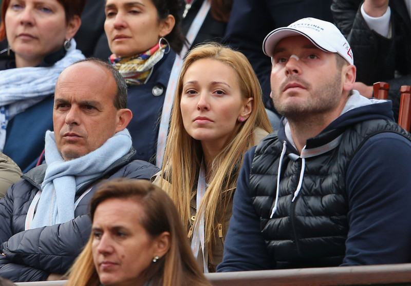 . Novak Djokovic of Serbia\'s girlfriend Jelena Ristic and physiotherapist Milan Amanovic (R) watch his Men\'s Singles match against David Goffin of Belgium during day three of the French Open at Roland Garros on May 28, 2013 in Paris, France.  (Photo by Julian Finney/Getty Images)