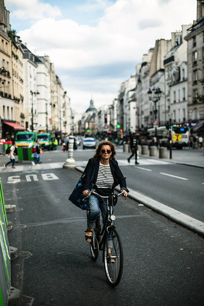 woman on bike riding paris.jpg