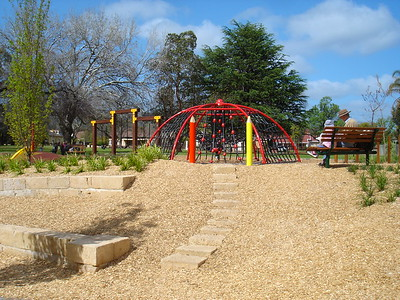 hexagonal steel climbing structure with nets and sandstone block steps