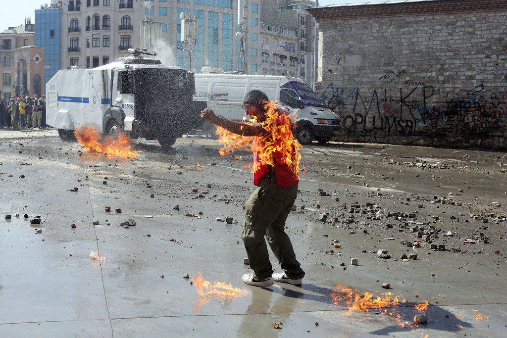 . A demonstrator\'s clothes are set on fire during clashes with riot police in Taksim square on June 11, 2013. Riot police stormed Istanbul\'s protest square on june 11, firing tear gas and rubber bullets at firework-hurling demonstrators in a fresh escalation of unrest after Turkish Prime Minister Recep Tayyip Erdogan said he would meet with protest leaders.     OREN ZIV/AFP/Getty Images