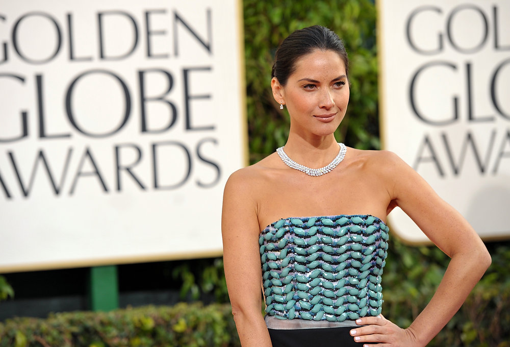 Description of . Actress Olivia Munn arrives at the 70th Annual Golden Globe Awards at the Beverly Hilton Hotel on Sunday Jan. 13, 2013, in Beverly Hills, Calif. (Photo by John Shearer/Invision/AP)