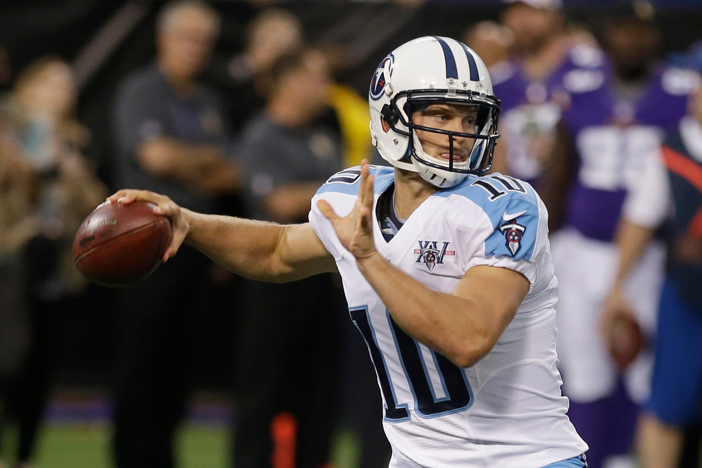 . Titans quarterback Jake Locker throws a pass during the first quarter against the Vikings. (AP Photo/Jim Mone)