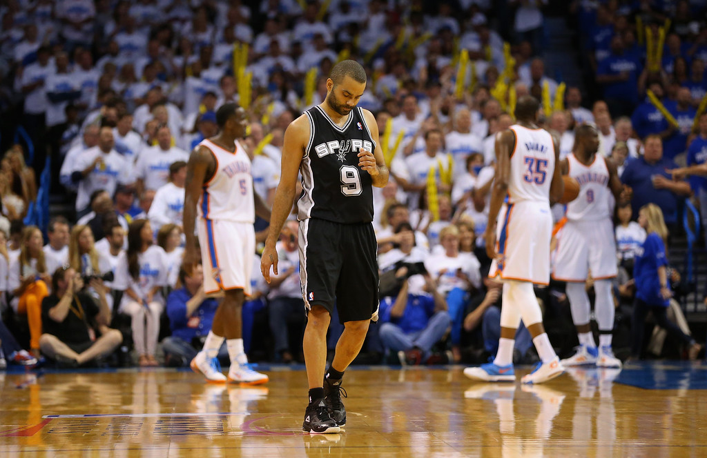 . OKLAHOMA CITY, OK - MAY 27:  Tony Parker #9 of the San Antonio Spurs looks on in the third quarter against the Oklahoma City Thunder during Game Four of the Western Conference Finals of the 2014 NBA Playoffs at Chesapeake Energy Arena on May 27, 2014 in Oklahoma City, Oklahoma. (Photo by Ronald Martinez/Getty Images)