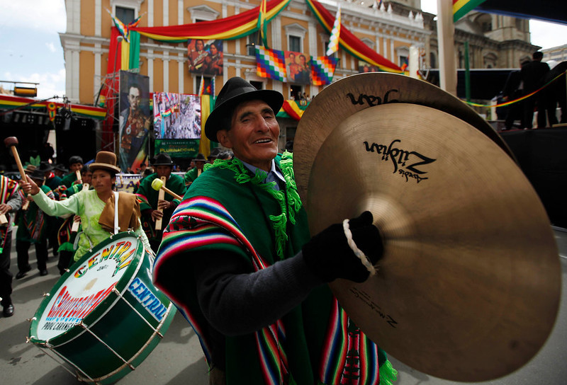 ". Musicians perform after Bolivia\'s President Evo Morales, not in picture, delivered his state of the nation address in La Paz, Bolivia, Tuesday, Jan. 22, 2013. Morales is marking his seventh year as president. During his address Morales said his ally Hugo Chavez ""is now receiving physical therapy\"" after cancer surgery in Cuba so that he can return home to Venezuela. Morales says he expects to see the Venezuelan president attending \""international events\"" soon. (AP Photo/Juan Karita)"