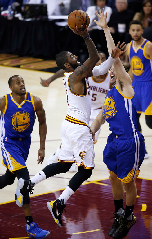 . Cleveland Cavaliers guard Kyrie Irving (2) drives on Golden State Warriors guard Klay Thompson (11) during the first half of Game 3 of basketball\'s NBA Finals in Cleveland, Wednesday, June 7, 2017. (AP Photo/Ron Schwane)