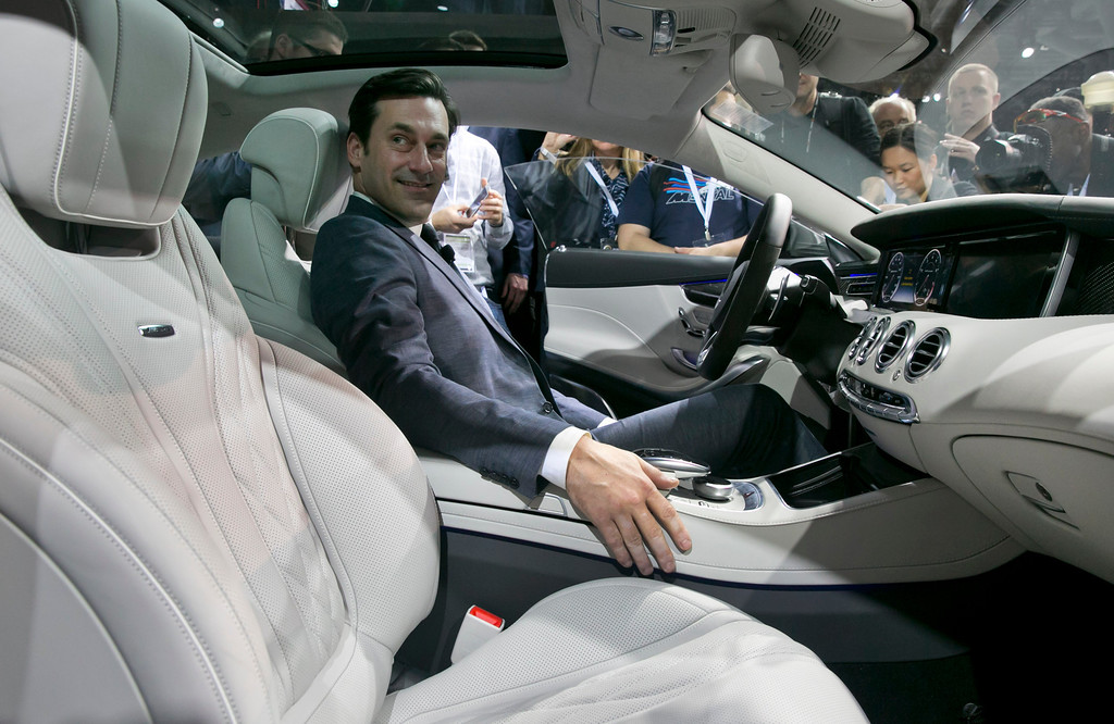 ". Actor Jon Hamm, of television\'s ""Mad Men,\"" sits in the 2015 Mercedes Benz S63 AMG Coupe, during its introduction at the 2014 New York International Auto Show at the Javits Convention Center, Wednesday, April 16, 2014, in New York.  (AP Photo/Richard Drew)"
