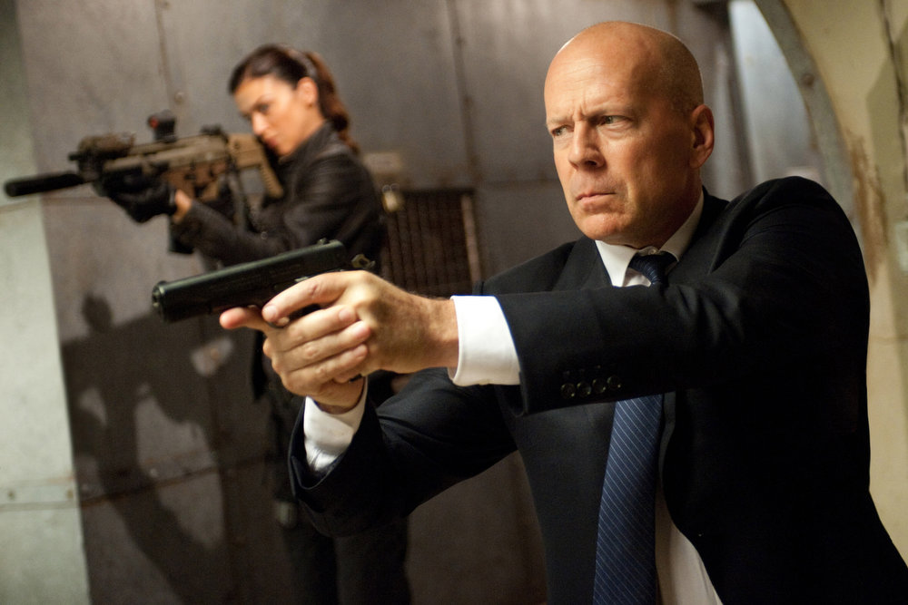 Description of . Left to right: Adrianne Palicki plays Lady Jaye and Bruce Willis plays Colton in G.I. JOE: RETALIATION, from Paramount Pictures, MGM, and Skydance Productions. (Jaimie Trueblood/Paramount Pictures)