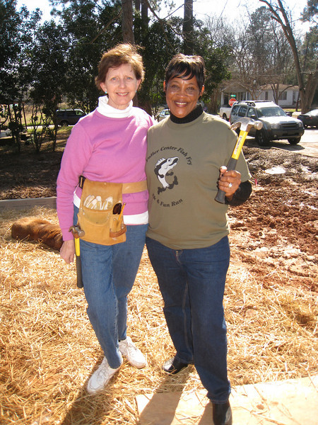 """10 02-03 Linda Fuller and Gloria Bryant keep putting the 'theology of the hammer"""" to work.  ff"""