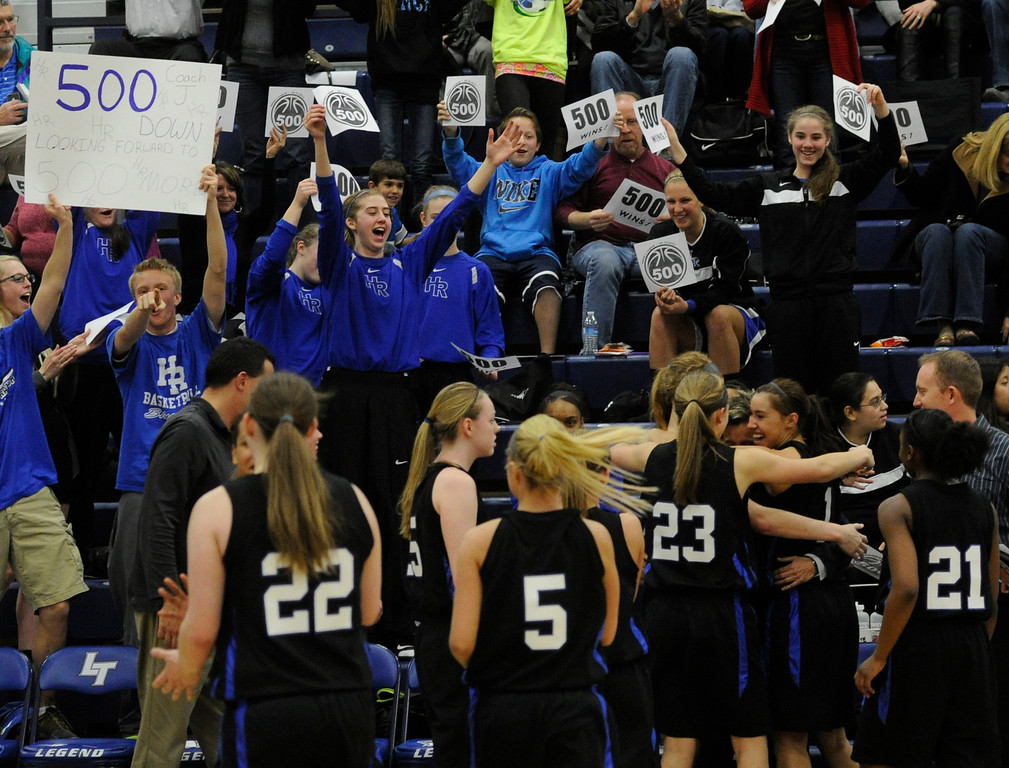 . PARKER, CO. - FEBRUARY 15: Falcons players hugged coach Caryn Jarocki as time expired Friday night. The Highlands Ranch High School girls\'s basketball team defeated Legend 76-31 Friday night, February 15, 2013. Falcon\'s coach Caryn Jarocki earned her 500th career win. (Photo By Karl Gehring/The Denver Post)