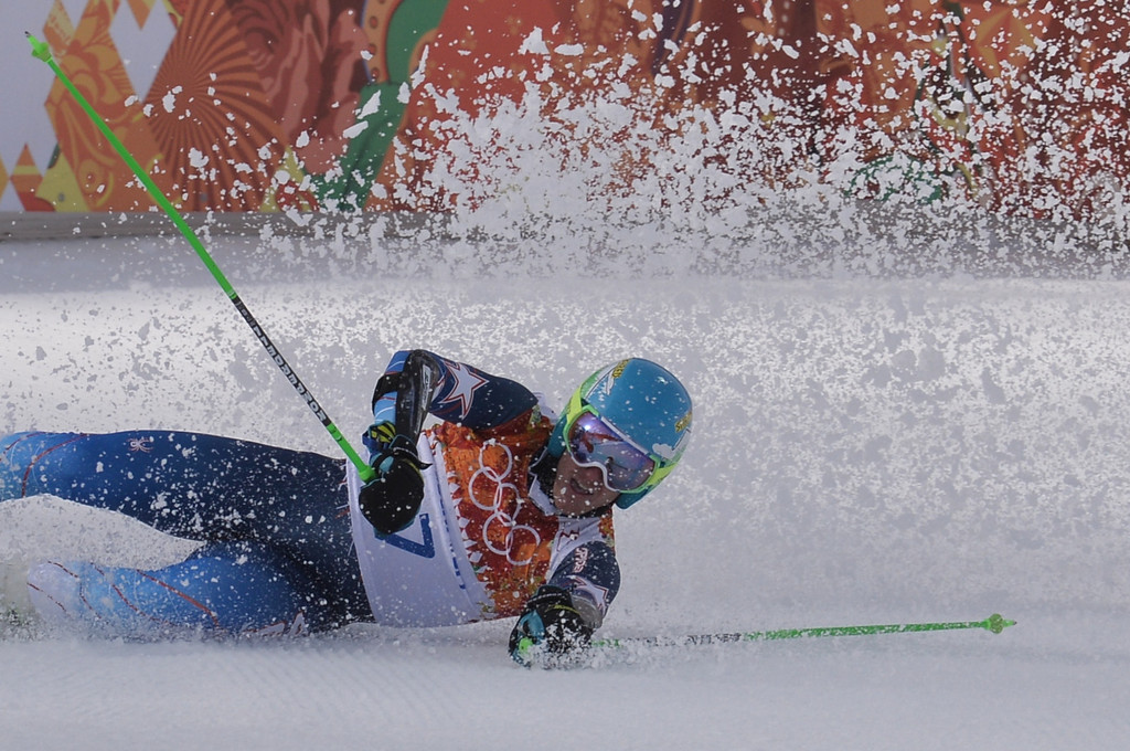 . US skier Ted Ligety falls in the finish area of the Men\'s Alpine Skiing Giant Slalom Run 2 at the Rosa Khutor Alpine Center during the Sochi Winter Olympics on February 19, 2014.      AFP PHOTO / DIMITAR  DILKOFF/AFP/Getty Images