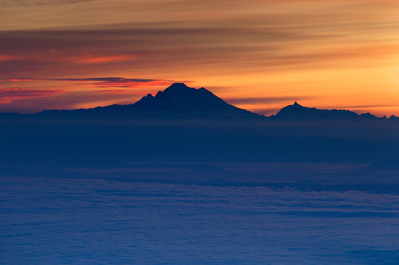 Blue Mountain Sunrise with Mount Baker rising above the fog across the Strait of Juan de Fuca. 08.11