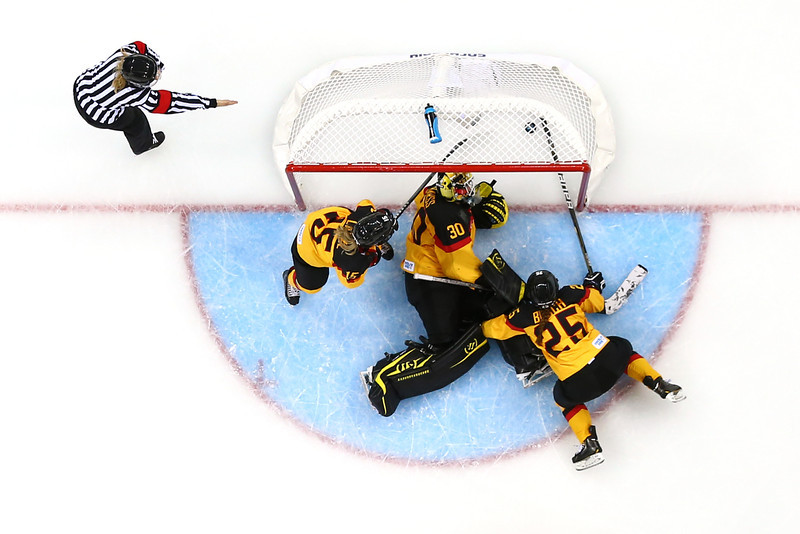 . Jennifer Harss #30, Andrea Lanzl and Franziska Busch #25 of Germany fail to stop the Sweden\'s third goal in the third period during the Women\'s Ice Hockey Preliminary Round Group B game on day four of the Sochi 2014 Winter Olympics at Shayba Arena on February 11, 2014 in Sochi, Russia.  (Photo by Bruce Bennett/Getty Images)