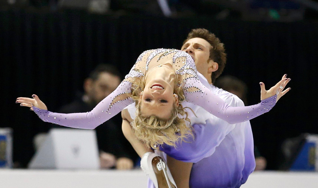 . Kirsten Moore-Towers and Dylan Moscovitch (rear) of Canada perform their free skating program  at the ISU World Figure Skating Championships in London, March 15, 2013.  REUTERS/Mark Blinch