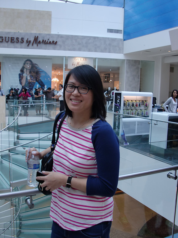 . Sheila Prospero of Encino waits for her turn to enter the Westfield Topanga mall Apple Store so she could buy an iPhone 5s before leaving on a trip. It was her second time waiting in line on an iPhone-debut day. (Photo by Steven Rosenberg/Los Angeles Daily News)