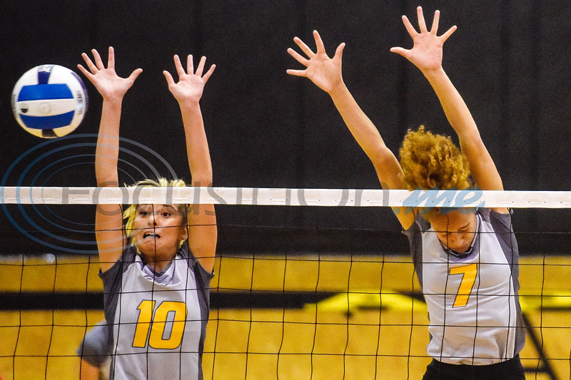 Tyler Junior College's Isabela Dobra (10) and Taya Mitchell (7) jump to block the ball during a college volleyball game at Tyler Junior College in Tyler, Texas, on Wednesday, Sept. 19, 2018. (Chelsea Purgahn/Tyler Morning Telegraph)