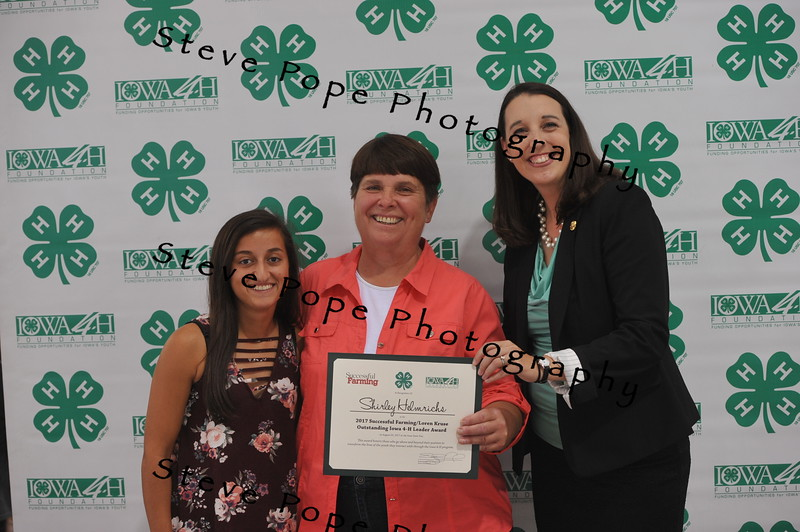 Shirley Helmrichs, of Manchester, (center) was presented with an award at the Iowa State Fair on Aug. 20. (Iowa State Fair/ Steve Pope Photography)