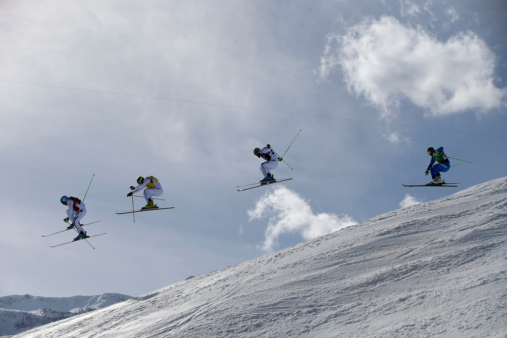 . Jean Frederic Chapuis of France, left, leads compatriots Jonathan Midol, second left,  Jonas Devouassoux, third left, and Austria\'s Andreas Matt during the second men\'s ski cross quarterfinal at the Rosa Khutor Extreme Park, at the 2014 Winter Olympics, Thursday, Feb. 20, 2014, in Krasnaya Polyana, Russia. (AP Photo/Sergei Grits)