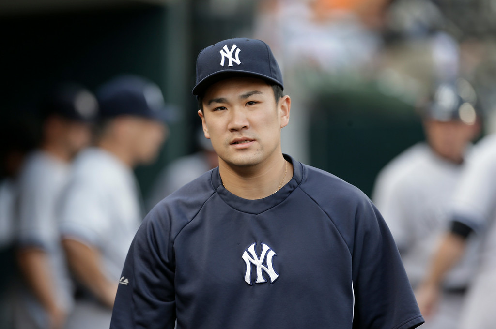 . New York Yankees pitcher Masahiro Tanaka watches from the dugout against the Detroit Tigers in the first inning of a baseball game in Detroit Wednesday, Aug. 27, 2014. (AP Photo/Paul Sancya)
