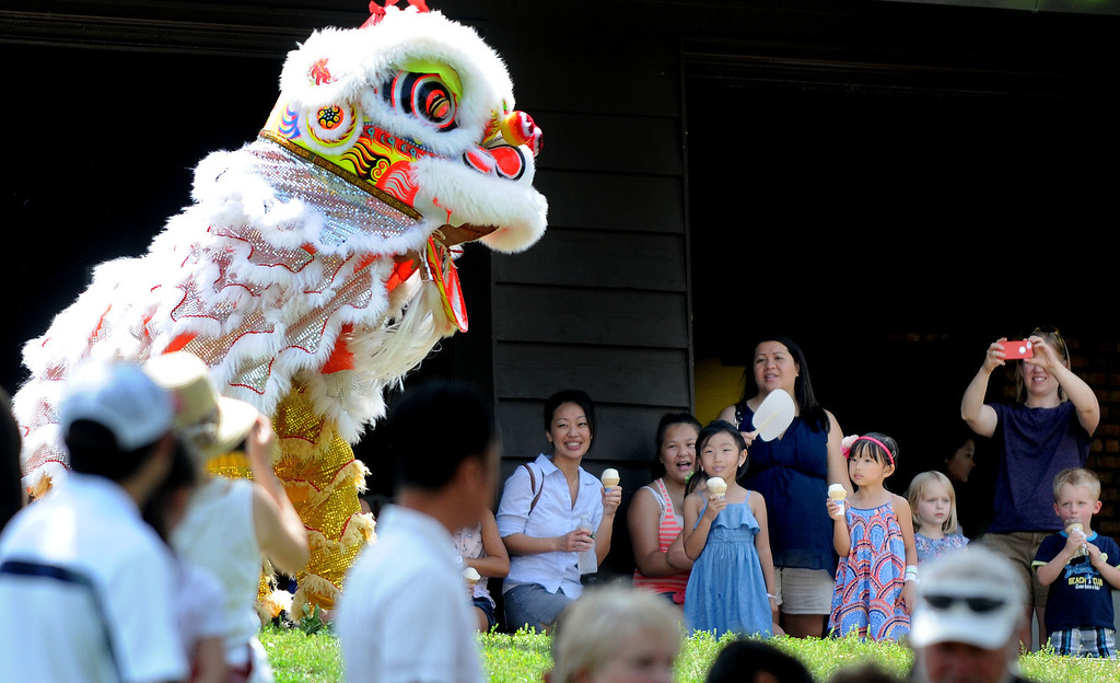 . The Ha Family Lions Troupe entertain the crowd near the main stage during the Dragon Festival at Phalen Park. (Pioneer Press: Sherri LaRose-Chiglo)
