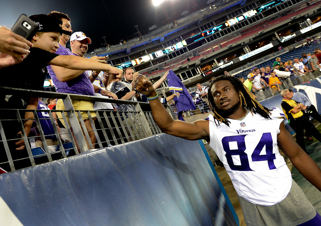 . Minnesota Vikings wide receiver Cordarrelle Patterson greets fans after the Vikings beat the Tennessee Titans 19-3 in a preseason NFL football game. (AP Photo/Mark Zaleski)
